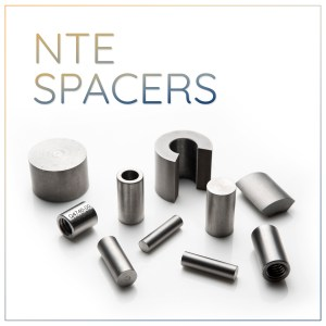 Negative Thermal Expansion Spacers for Optics